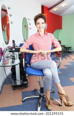 Beautiful young woman in beauty salon - stock photo
