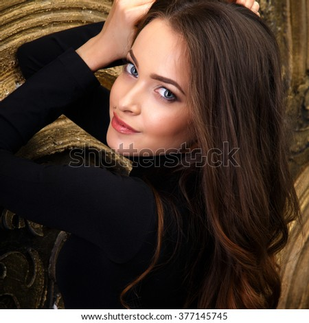 Beautiful young woman in black bodies over dark background. Beauty fashion portrait