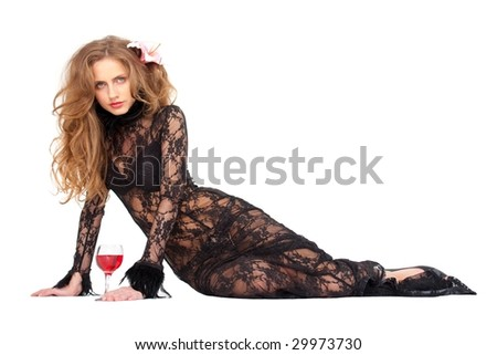 beautiful young woman in black dress with wine sitting against isolated white background