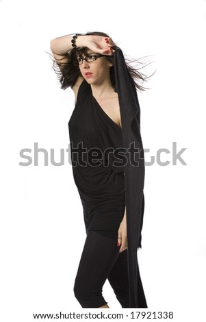 Beautiful young woman in black wearing glasses, posing with wind in her hair. Isolated on white