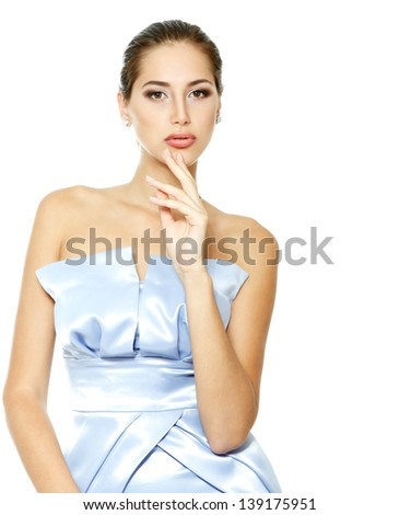 beautiful young woman in blue elegant dress, portrait of girl looking at camera, isolated on white background - stock photo