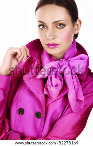 Beautiful young woman in bright autumn coat - stock photo