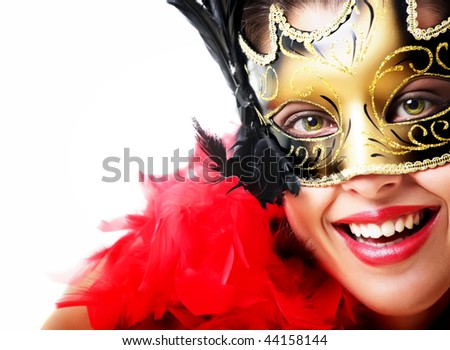 Beautiful young woman in carnival mask and feather boa. Isolated on white background. - stock photo