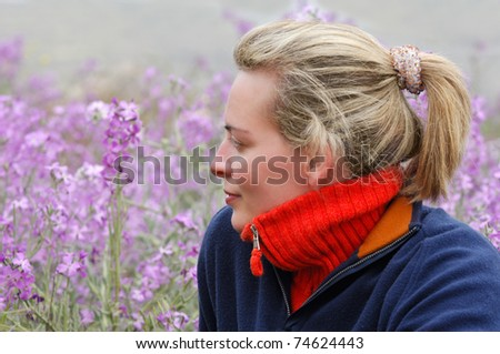 Beautiful young woman in casual clothes, enjoying the countryside during an early spring morning - stock photo