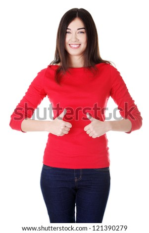 Beautiful young woman in casual clothes gesturing thumbs up.