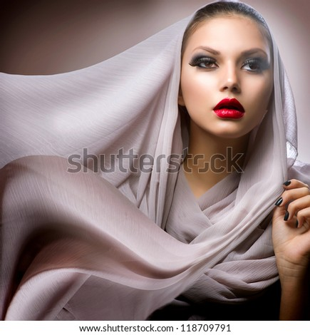 Beautiful Young Woman in Chiffon Scarf - stock photo