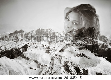 Beautiful young woman in double exposure with mountain landscape. Vintage vignetting look.