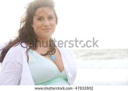 Beautiful Young Woman in Dreamy Lighting On the Beach - stock photo