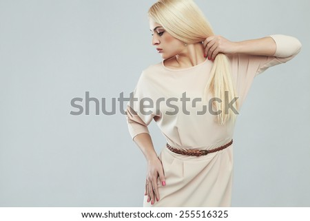 beautiful young woman in dress.Fashionable Sexy blond girl.model with strong healthy hair - stock photo