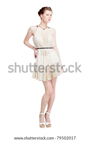 Beautiful young woman in dress isolated on white - stock photo