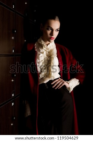 Beautiful young woman in fashion clothes - stock photo