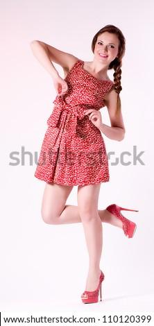 Beautiful young woman in fashion pink dress - stock photo