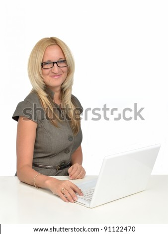 Beautiful young woman in front of the computer in the office