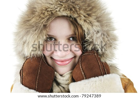 Beautiful young woman in fur hood of winter coat - stock photo