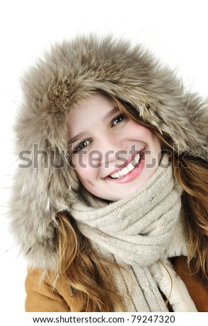 Beautiful young woman in fur hood of winter coat on white background