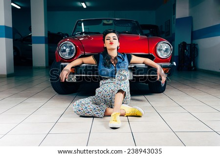 Beautiful young woman in garage  - stock photo