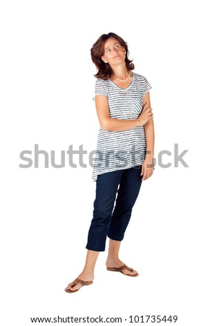 Beautiful young woman in her 30s standing with her hands folded against white background and wearing top with stripes and jeans - stock photo