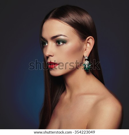 beautiful young woman in jewelry.beauty brunette girl with red lips - stock photo