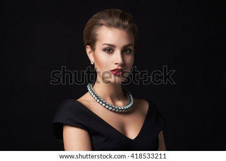 beautiful young woman in jewelry.Beauty girl with short hair and make-up.elegant lady - stock photo