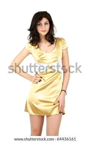 Beautiful young woman in little yellow silk dress isolated over white background - stock photo
