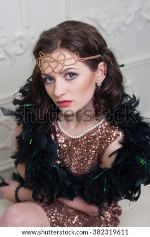 Beautiful young woman in luxurious dress retro. Vogue style vintage