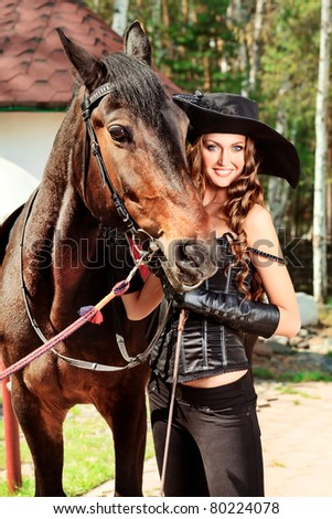 Beautiful young woman in medieval costume is riding on horseback. - stock photo