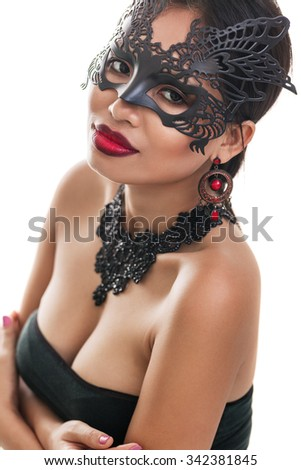 Beautiful young woman in mysterious venetian carnival mask. Fashion photo isolated on white background