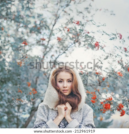 Beautiful young woman in mystical woods - stock photo