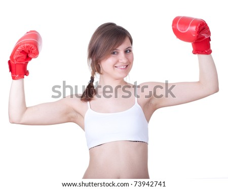 beautiful young woman in pair of red boxing gloves