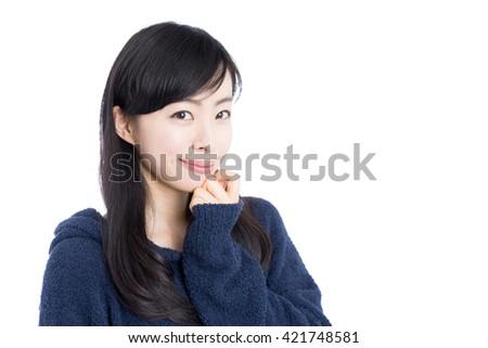 Beautiful young woman in pajamas - stock photo