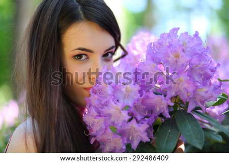 beautiful young woman in park - stock photo