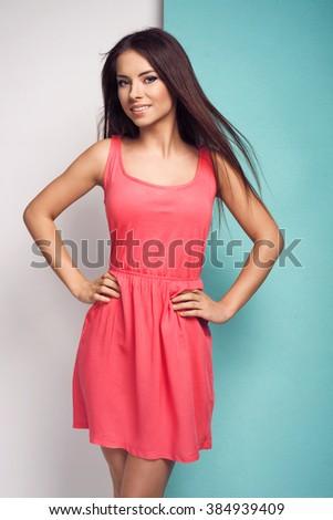 Beautiful young woman in pink dress. Summer fashion photo - stock photo