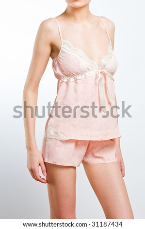 Beautiful young woman in pink lingerie, studio shot - stock photo