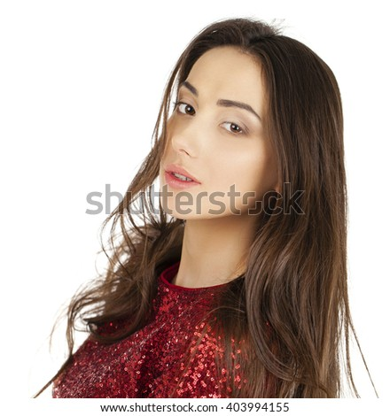 Beautiful young woman in red dress posing in the studio on a white background