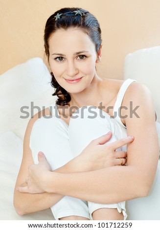 Beautiful young woman in room interior