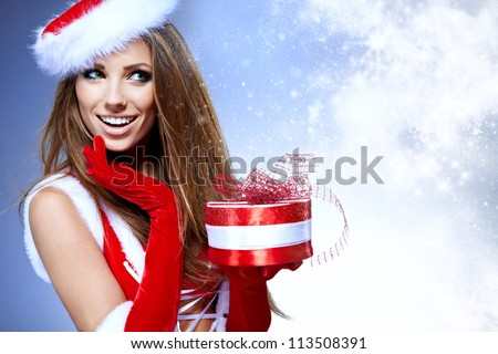 Beautiful young woman in Santa Claus clothes - stock photo