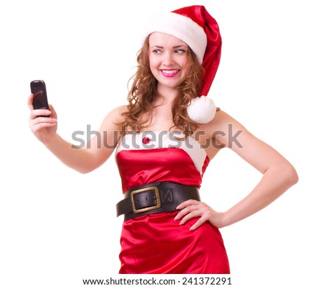 Beautiful young woman in Santa Claus clothes with telephone on white background.