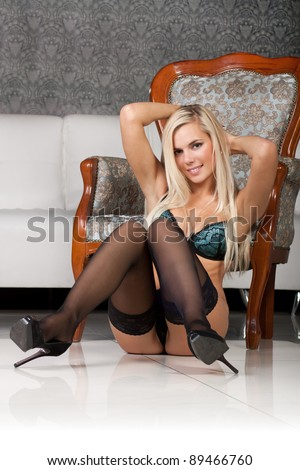 Beautiful young woman in sexy black lingerie - stock photo