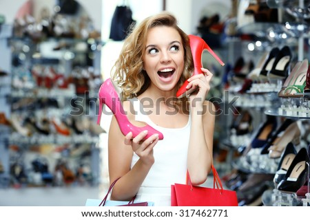 Beautiful young woman in shop - stock photo