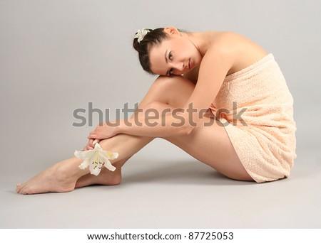 beautiful young woman in spa - stock photo