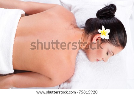 beautiful young woman in spa salon - stock photo