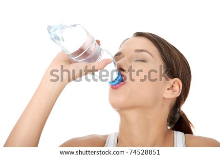 Beautiful young woman in sport cloathes with bottle of mineral water