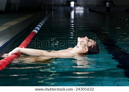 beautiful young woman in sport swimming pool - stock photo