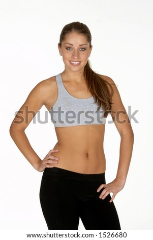 Beautiful Young Woman in Sports Bra and Tights - stock photo