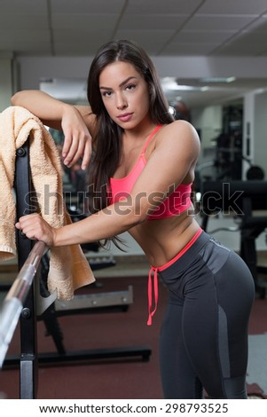 Beautiful young woman in sports clothing in the gym - stock photo