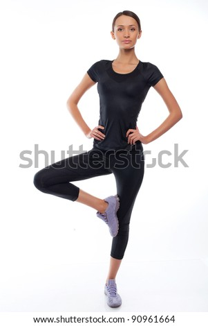 beautiful young woman in sports wear on a white background - stock photo