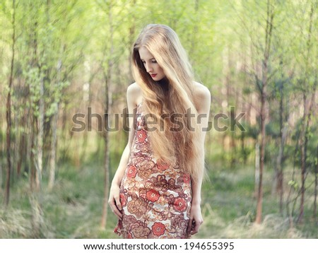 Beautiful young woman in summer garden. Beauty summertime - stock photo