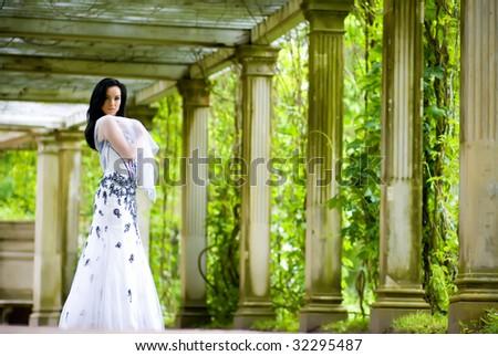 Beautiful young woman in summerhouse - stock photo