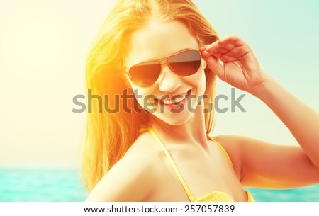 beautiful young woman in sunglasses summer sea beach - stock photo