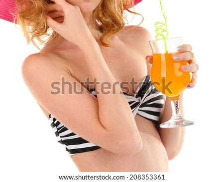 Beautiful young woman in swimsuit and hat with cocktail isolated on white - stock photo